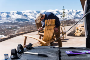 Man staining wood chair